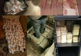 Московский полицейский набрал взяток на две тонны денег (видео)